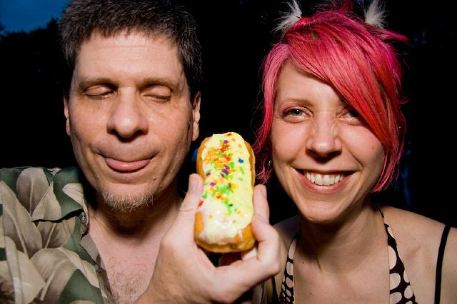 Maria and Daniel at the lake party photograph with day-glo donut